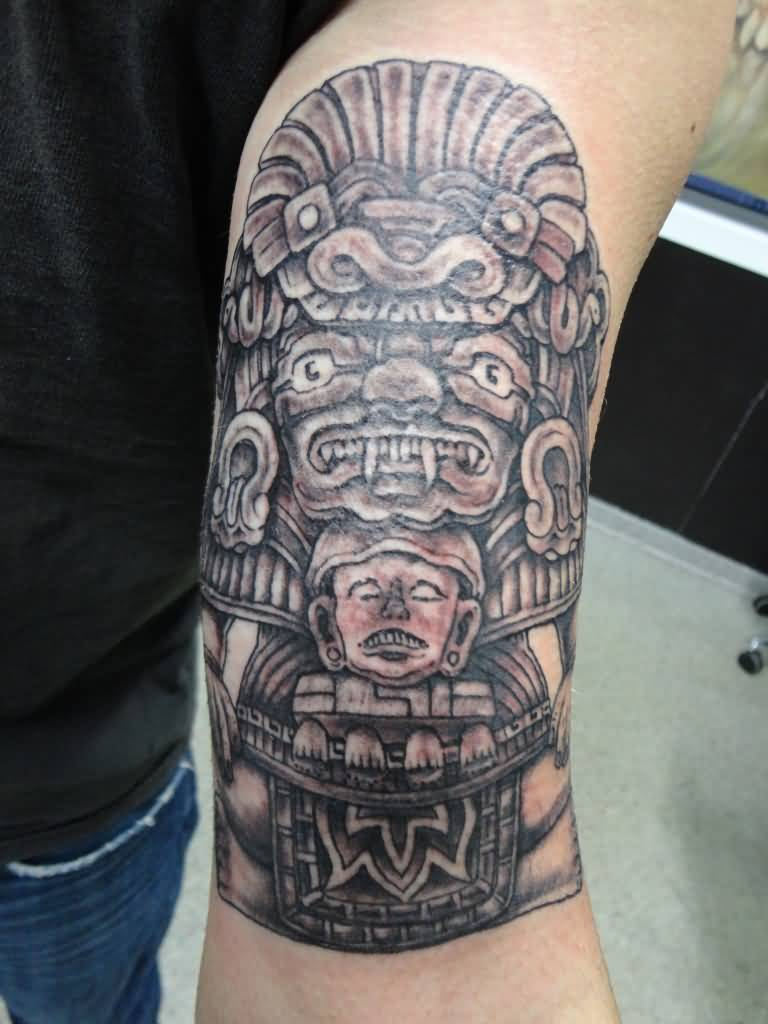 Realistic grey mayan tattoo on left shoulder for Mayan tattoos designs