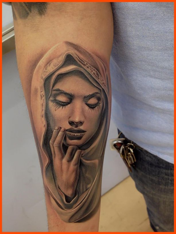 man right half sleeve virgin mary tattoo
