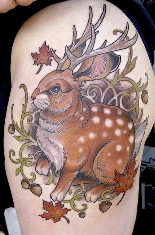 jackalope tattoo on left shoulder