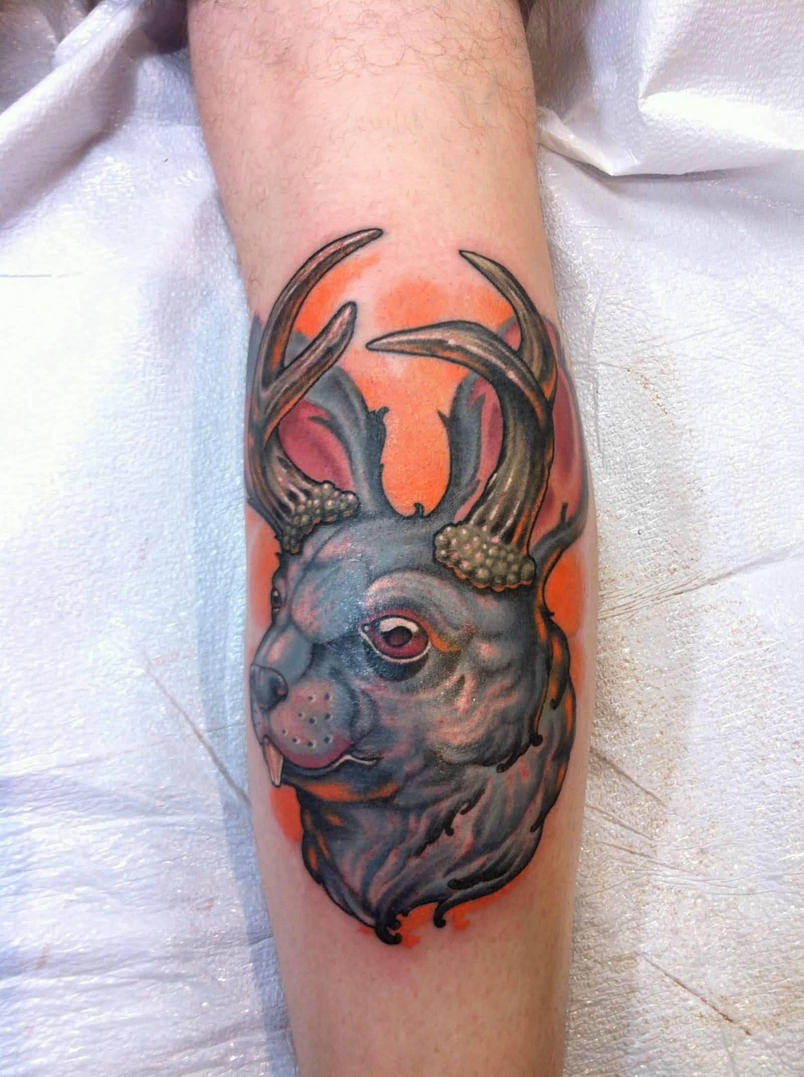 jackalope tattoo on leg
