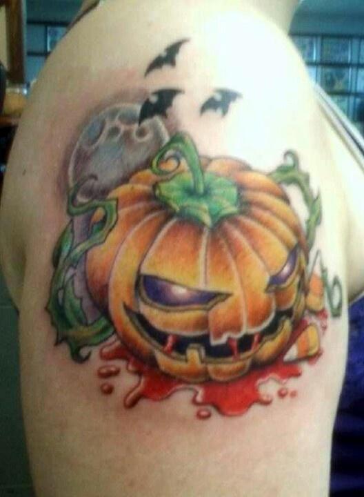 35 latest evil pumpkin tattoo for Tattoos of pumpkins