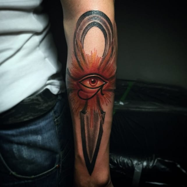 Beautiful eye in ankh tattoo by lucas for Cross tattoo under left eye meaning