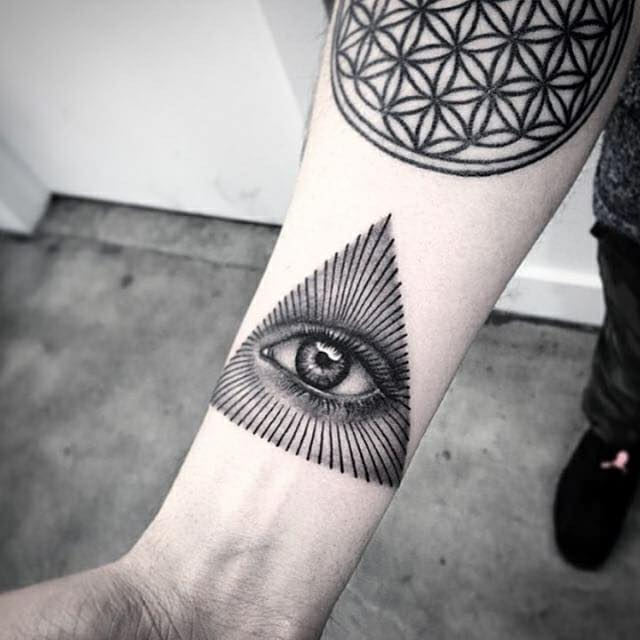 Black Trianglw Eye Tattoo On Forearm