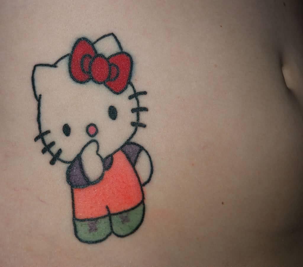 84abadea7 Colored Hello Kitty Tattoo On Right Hip