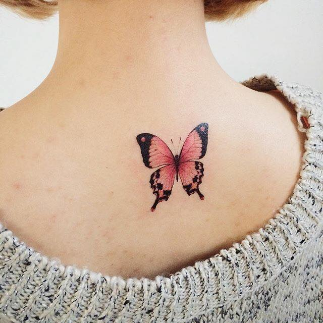 Awesome flowers and butterfly tattoo on upper back for Cute butterfly tattoos