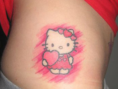 Cute pink hello kitty with heart tattoo on side rib for Cute side tattoos