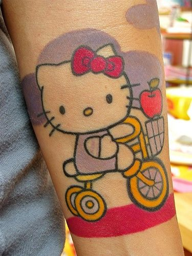 10 hello kitty tattoos for bicep for Hello kitty tattoo sleeve