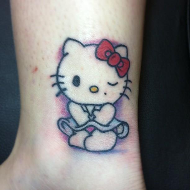 Something Hello kitty lip tattoo something is