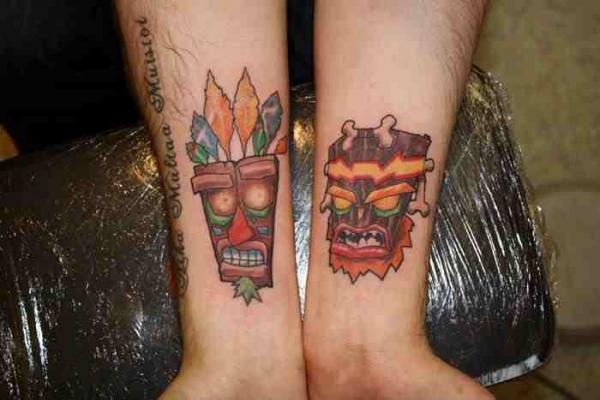 Aku aku and uka uka tattoos on forearm for Aku aku tattoo
