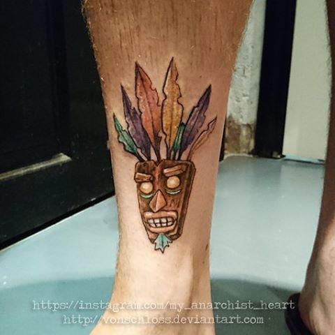 10 incredible aku aku tattoo designs for Aku aku tattoo