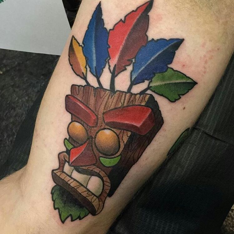 Colored aku aku tattoo on arm sleeve for men for Aku aku tattoo