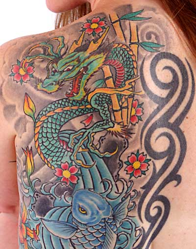 Dragon fish tattoo on left back shoulder for Koi dragon tattoo meaning