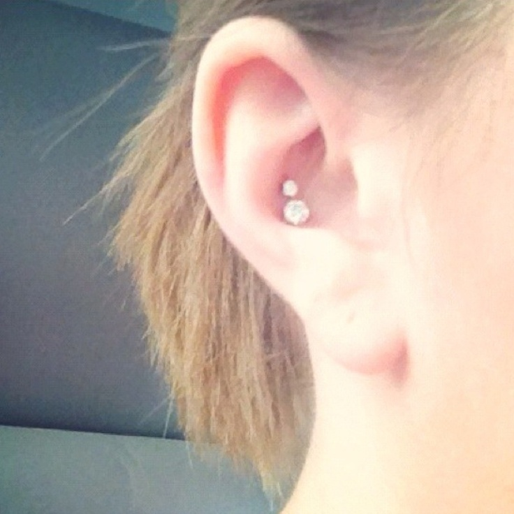 dual inner conch piercing on girl right ear. Black Bedroom Furniture Sets. Home Design Ideas