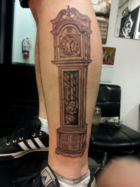 grandfather clock face tattoo. grandfather clock tattoo on side leg face s