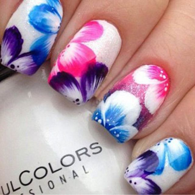 Adorable Flowers Nail Art Design On White Nails