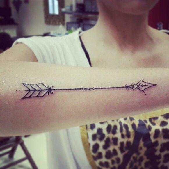 An Old Arrow Tattoo On Arm