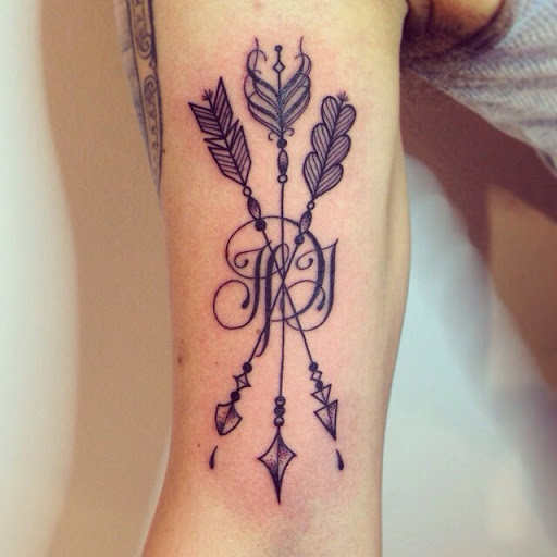 ffb6274c7 Beautiful Crossing Arrows Tattoo With Letter On Arm
