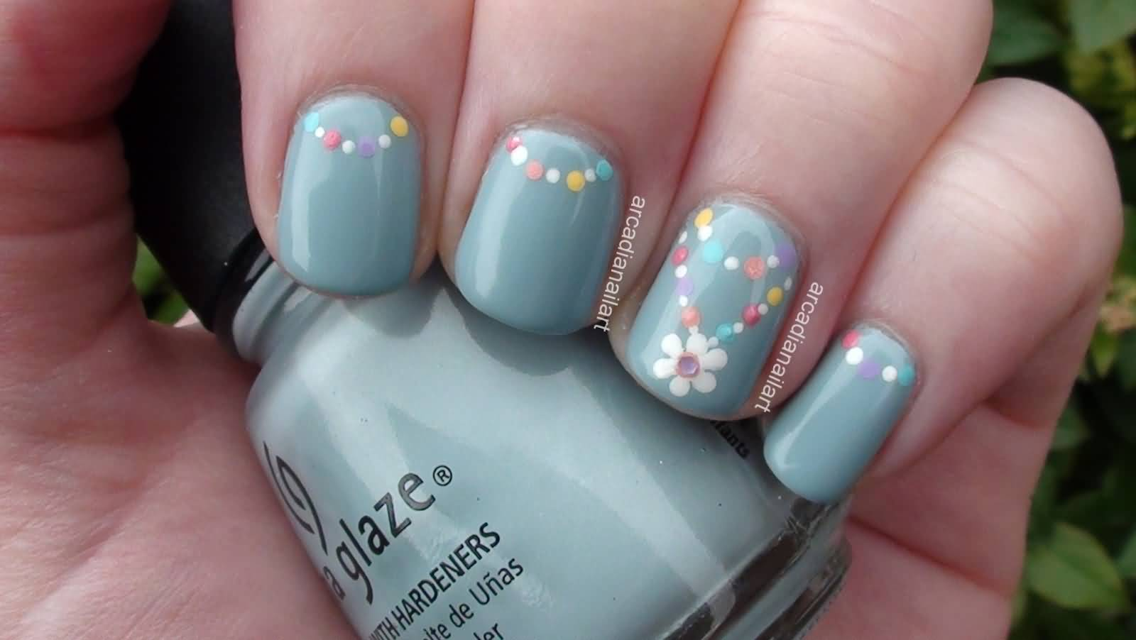 Colorful Polka Dots And Accent White Flower Nail Art