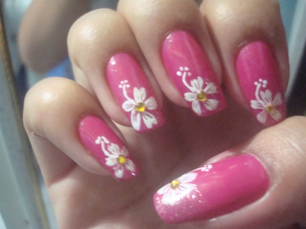 Pink Nails With White Hibiscus Flower Nail Art - 45 Very Cute Flower Nail Art Ideas Collection For Girls