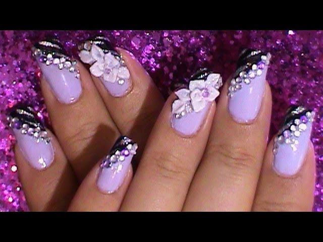 Purple Nails With Rhinestones And Flower Nail Art