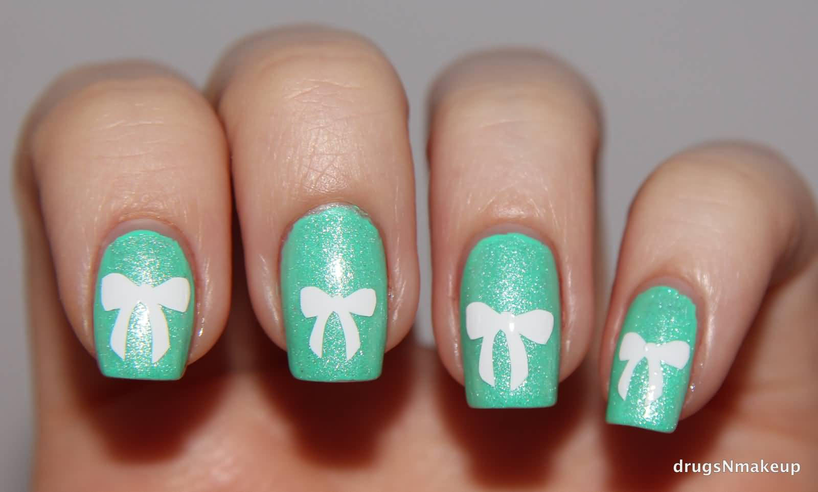 40 stylish and simple bow nail art design ideas simple white bow nail design on blue nails prinsesfo Gallery