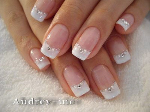 French Tip Nails With Rhinestones On Ring Finger
