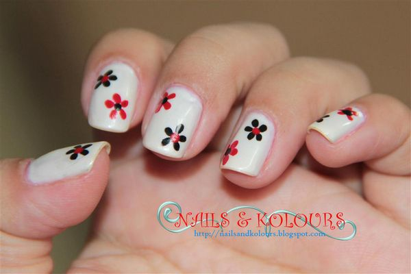 White Nails With Simple Black And Red Flower Nail Art - 45 Very Cute Flower Nail Art Ideas Collection For Girls
