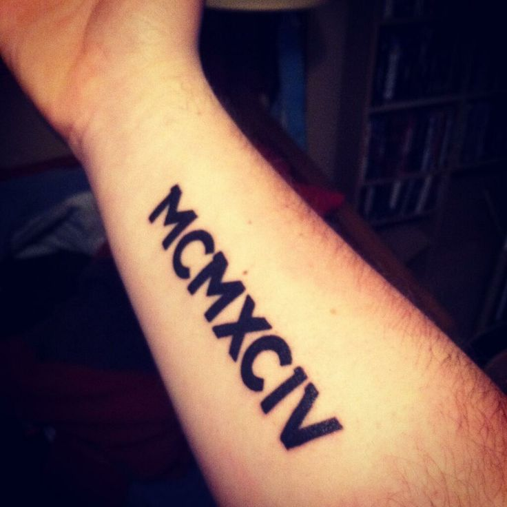 Beautiful black color roman numerals tattoo on forearm for Roman numerals tattoo on finger