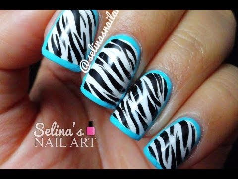 Black and white zebra print nail art with blue border design