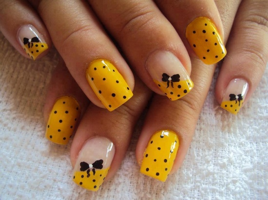 Black Polka Dots On Yellow Nails With Bow Design