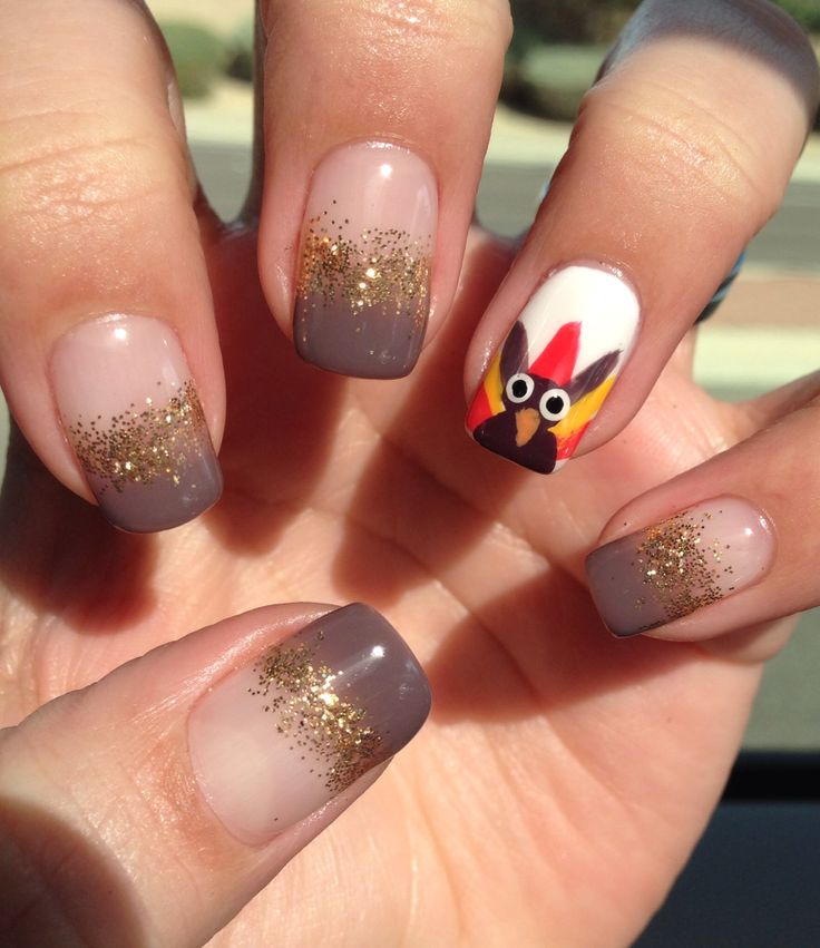 50 most beautiful thanksgiving nail art design ideas brown and gold glitter nails with accent turkey face thanksgiving nail art prinsesfo Choice Image