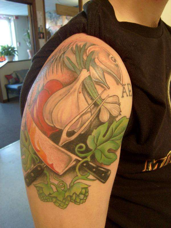 11 navy tattoos on shoulder
