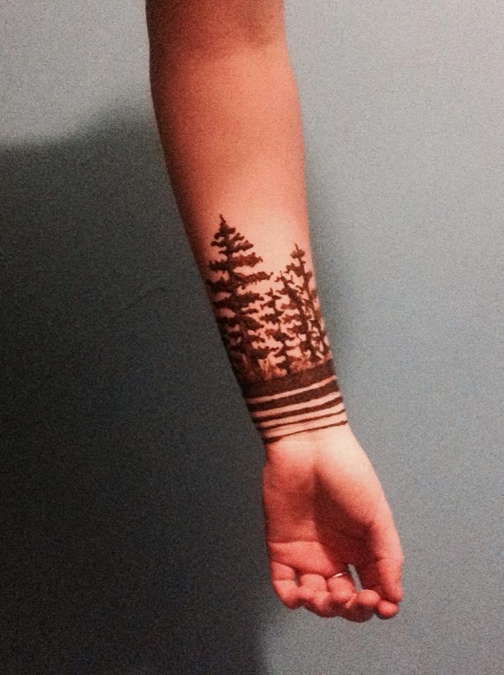Black Forest Tree Tattoo On Left Wrist