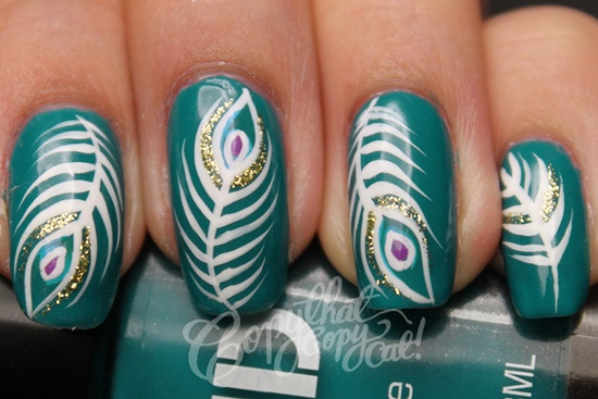 Green Nails With Peacock Feather Nail Art Design