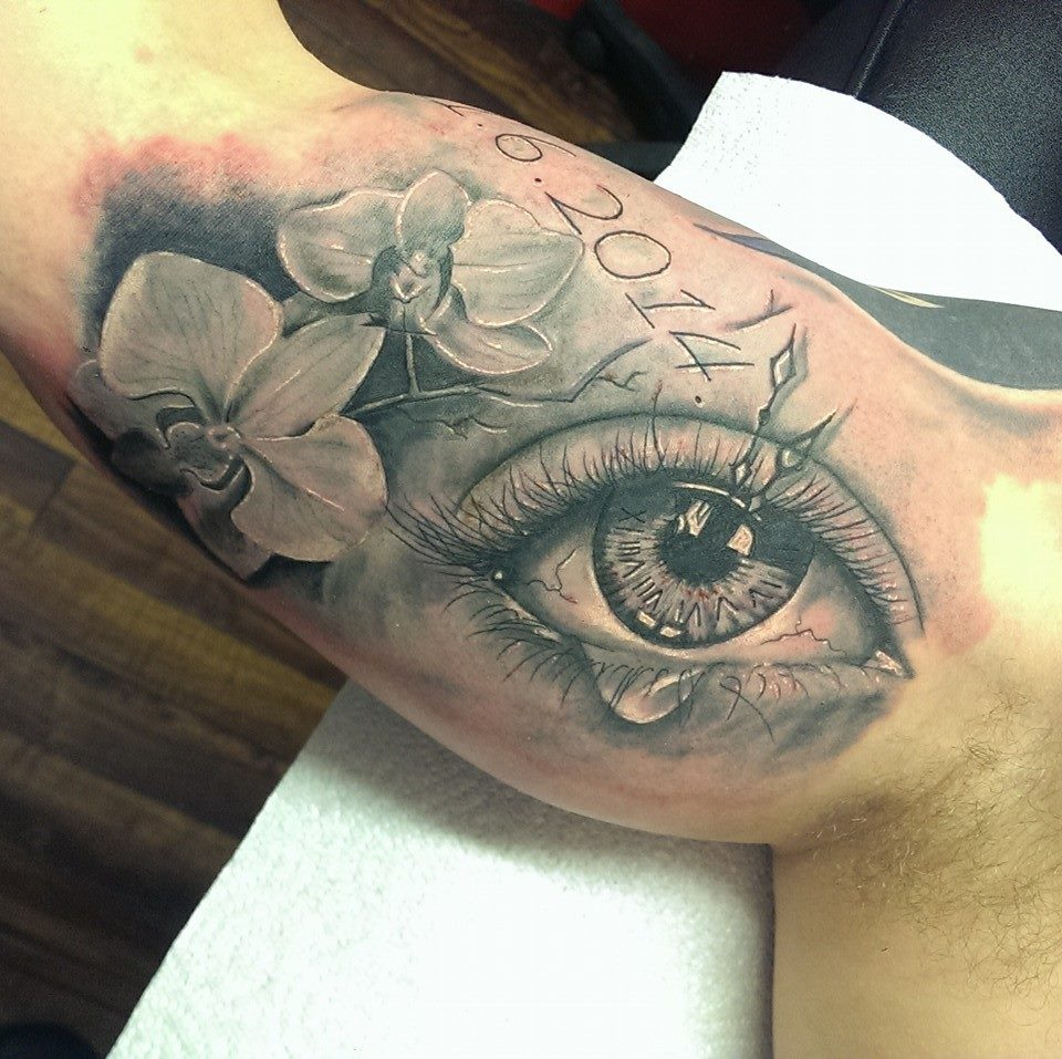 Grey Flowers And Crying Eye Tattoo On Inner Bicep by Marley Tattoo