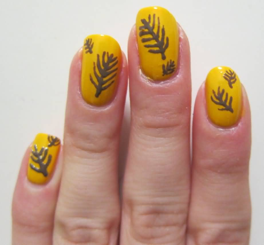 Yellow Nails With Feather Nail Design
