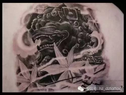 Black And Grey Foo Dog With Leaves Tattoo