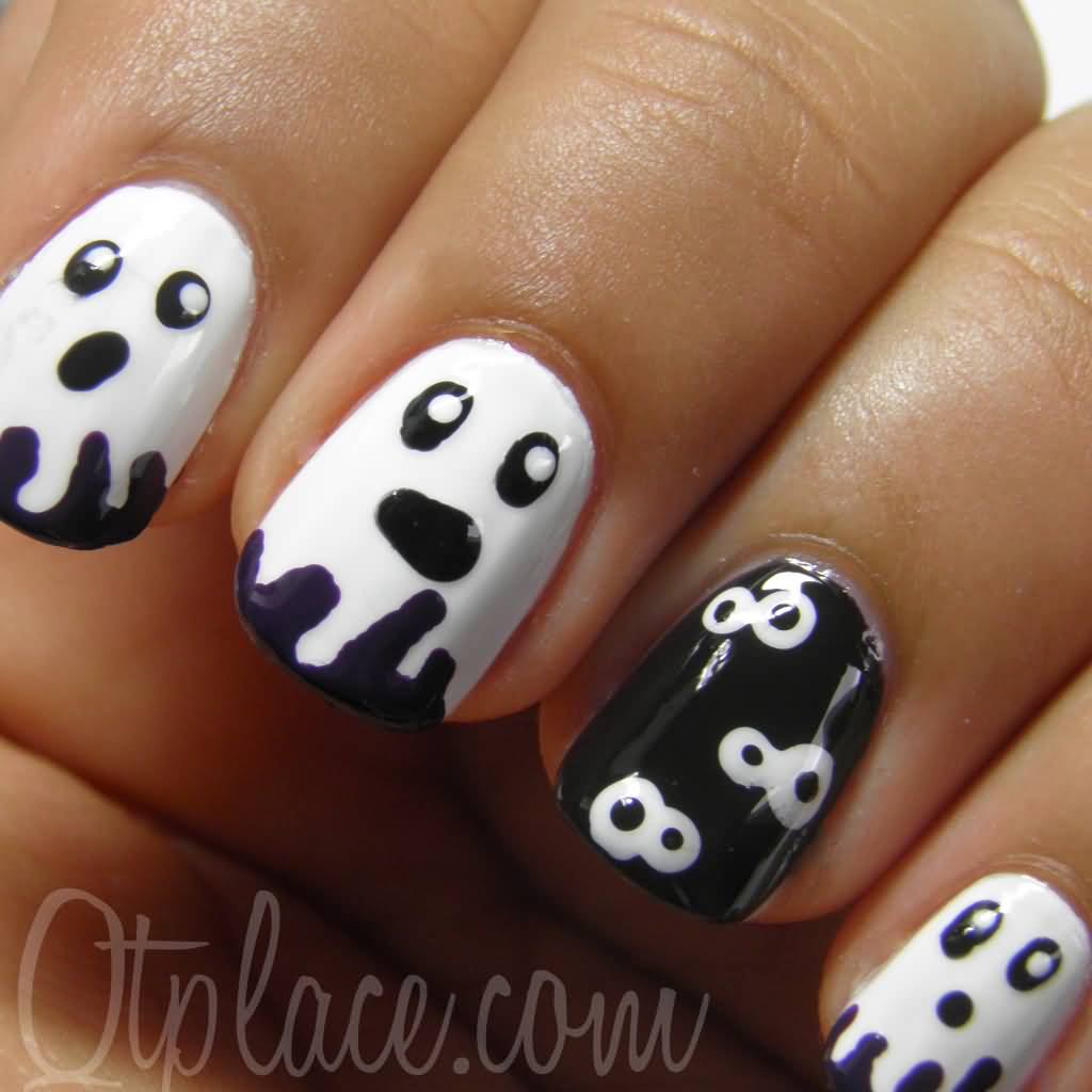 - Black And White Ghost Face Halloween Nail Art