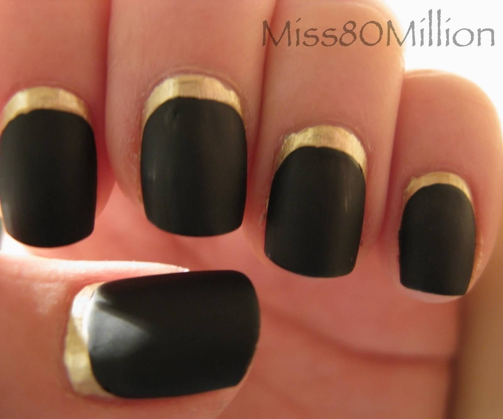Black Matte Nails With Gold Reverse French Tip Nail Art Design