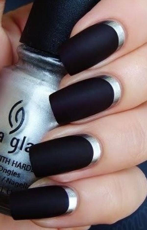 black matte nails with silver metallic reverse french tip nail art