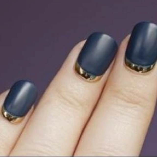 Black Nails With Gold Reverse French Tip Nail Art Design