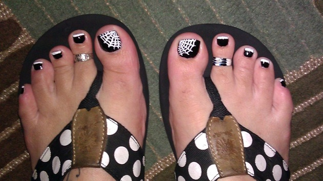 Black Toe Nails With White Spider Web Halloween Nail Art - 25+ Best Halloween Toe Nail Art Designs