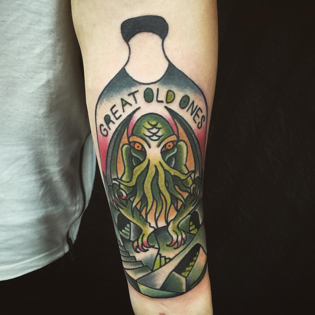 Green Ink Cthulhu Tattoo On Left Forearm