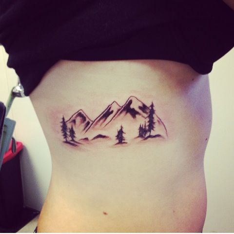 Mountains With Pine Trees Tattoo On Side Rib