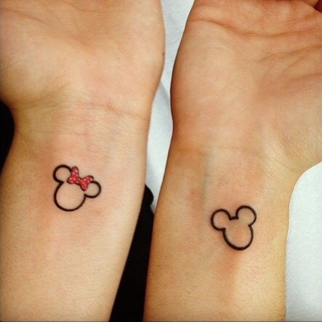 Small And Cute Micky And Minnie Mouse Matching Tattoo On Wrists