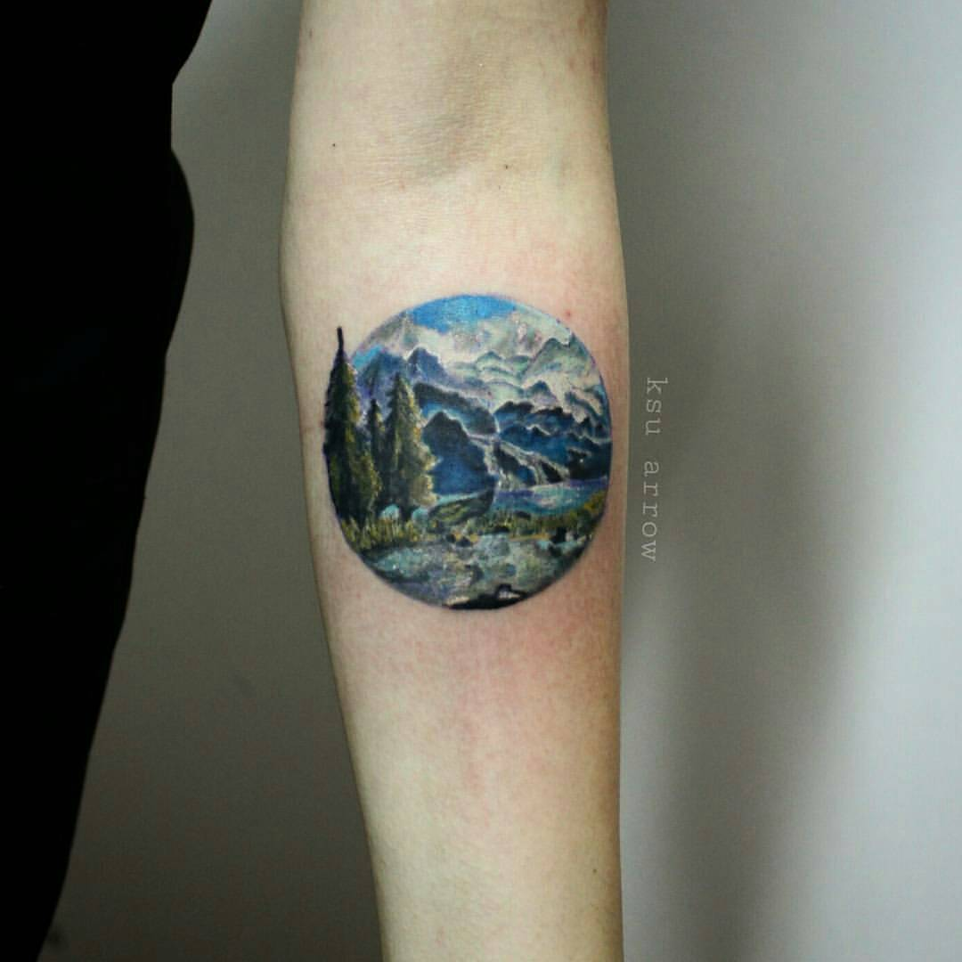 Small Colorful Mountains With Trees In Circle Tattoo On Forearm