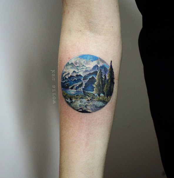 4a74a8205 Small Realistic Mountains Scene In Circle Tattoo On Forearm