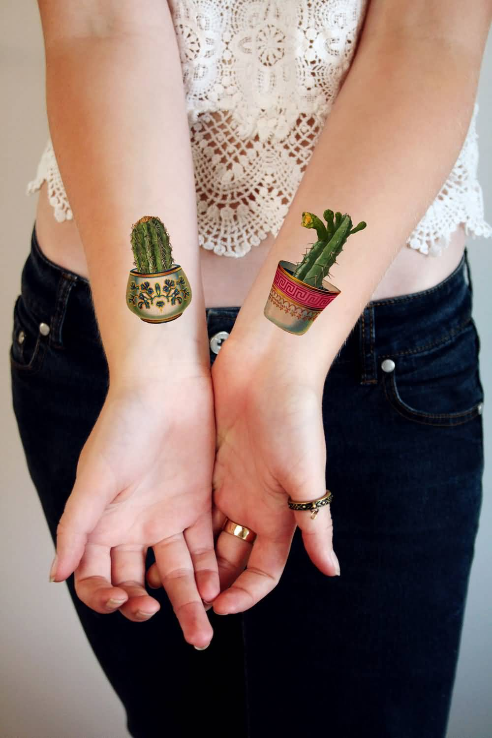 078123d108ab4 Small Wonderful Cactus In Pot Tattoos On Both Wrists
