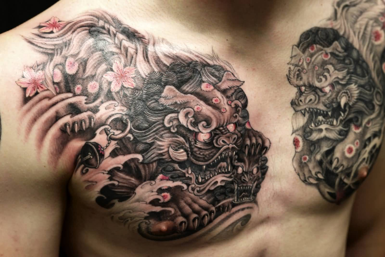 Superb black and grey colored foo dogs ripped skin tattoo for Black and grey chest tattoos