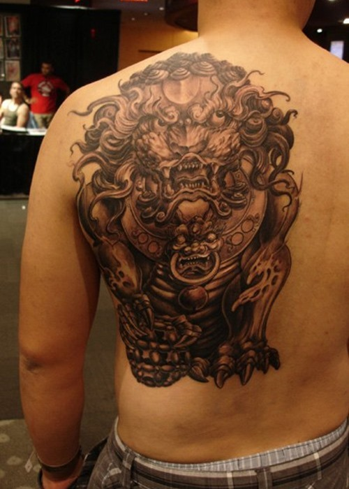 37 foo dog tattoos on back for Side back tattoo